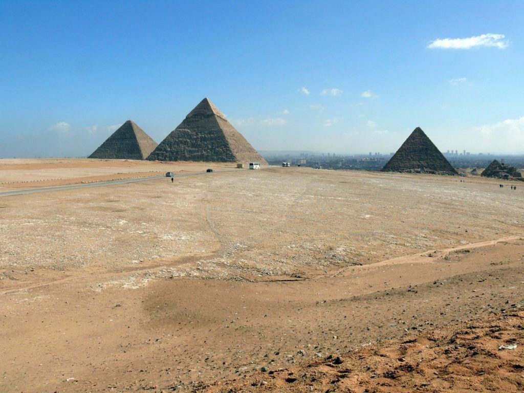 The main tourist attraction of Egypt, the Pyramids. In the background Cairo's buildings